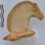 Зооморфная ручка сосуда с протомой лошади - один из наиболее ранних образцов терракотовой пластики, возродившейся с приходом эллинов в Бактрию, после длительного периода аниконизма.